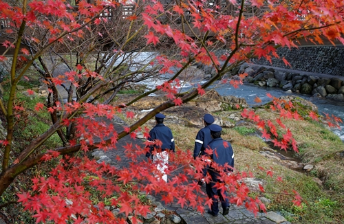 s police officers stand guard near a hot spring resort, the venue of the summit meeting between Japanese Prime Minister Shinzo Abe and Russian President Vladimir Putin, in Nagato