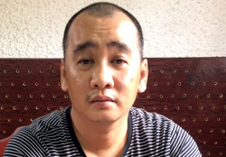Hồ Quang Nghĩa tại cơ quan điều tra. Ảnh: C.A