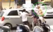 Tài xế ôtô rồ ga tông cảnh sát rồi chạy trốn