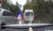 Ôtô chạy ngược chiều gặp công an bèn đi lùi