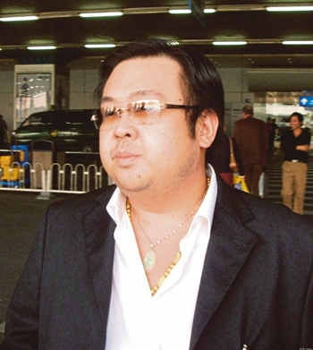 Kim Jong-nam, the estranged half-brother of North Korean leader Kim Jong-un, at the Beijing International Airport in 2004. In this picture, Jong-nam is seen wearing a gold chain with a pendant of the Buddha (hidden), which he had for a while. The top chain was not in his custody when he died. Pix courtesy of HUFFINGTON POST