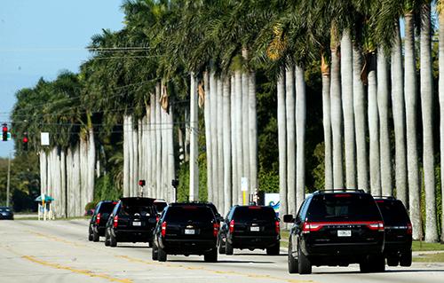 The motorcade of U.S. President DonaldTrumpmakes its way toTrumpInternational Golf Club in West Palm Beach, Florida, U.S., March 18, 2017. REUTERS/Kevin Lamarque