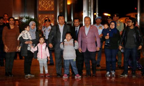 Các công dân Malaysia bị giữ ở Triều Tiên về nước. Ảnh: CNA