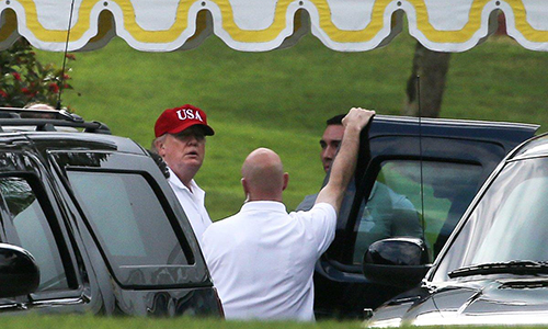 [Caption]President Trump walks into a vehicle as he leaves Mar-a-Lago estate in Palm Beach, Fla., on April 9.  (CARLOS BARRIA/REUTERS)
