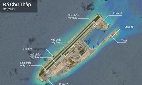 Loạt nhà chứa máy bay chiến đấu Trung Quốc ở Trường Sa. Bấm vào hình để xem chi tiết. Đồ họa: Việt Chung