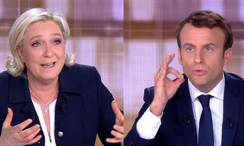 Hai ứng cử viên tổng thống Pháp Emmanuel Macron (phải) và Marine Le Pen trong cuộc tranh luận trên truyền hình. Ảnh: AFP.