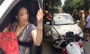 Nữ Việt kiều cố thủ trong ôtô khi bị cảnh sát thổi còi