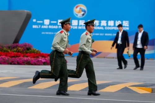 Paramilitary police officers run past the China National Convention Center, a venue of the upcoming Belt and Road Forum in Beijing, China, May 12, 2017. REUTERS/Thomas Peter 3/6leftright 4/6leftright 5/6leftright 6/6leftright 1/6