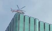 Máy bay hạ cánh trên nóc nhà cao tầng Sài Gòn