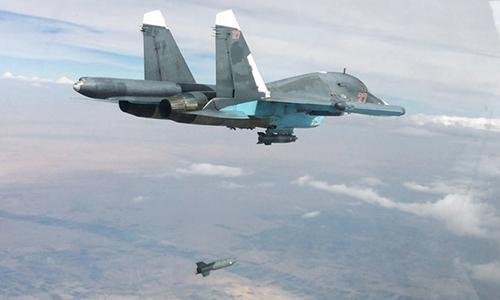 Máy bay Nga thả bom vào mục tiêu Nhà nước Hồi giáo ở Syria. Ảnh: RIA Novosti.