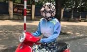 Người phụ nữ bịt kín mặt chống nóng như dị nhân ở Hà Nội