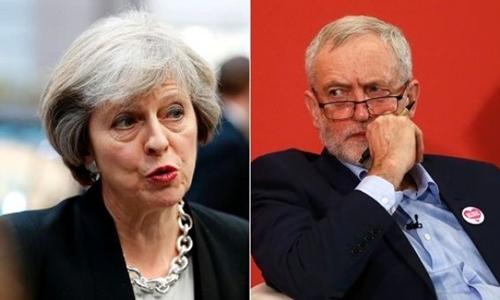 Bà Theresa May (trái) và ông Jeremy Corbyn. Ảnh: Reuters.