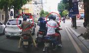 Cô gái đi SH bị 4 xe máy dàn cảnh cướp túi xách giữa phố Hà Nội