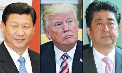 Chủ tịch Trung Quốc Tập Cận Bình, Tổng thống Mỹ Donald Trump và Thủ tướng Nhật Bản Shinzo Abe. Ảnh: AP.