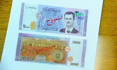 syria-lan-dau-in-chan-dung-tong-thong-assad-tren-tien