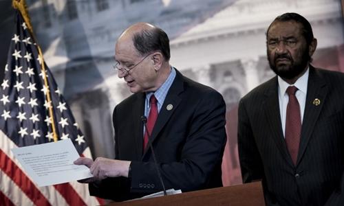 US Representative Brad Sherman (L), Democrat of California, and US Representative Al Green, Democrat of Texas,