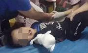 Bé trai đứt lìa cánh tay vì nghịch thang máy cuốn