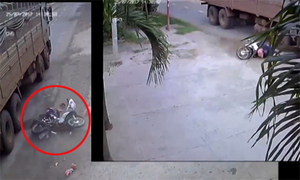 Xe tải bỏ chạy sau khi tông ngã xe máy