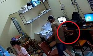 Thanh niên bảnh bao trộm iPhone 6 trong tiệm photo