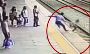 Nhân viên nhà ga phóng mình cứu cô gái tự tử ngay mũi tàu hoả