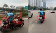 Quái xế lái xe máy bằng chân vào làn buýt nhanh BRT
