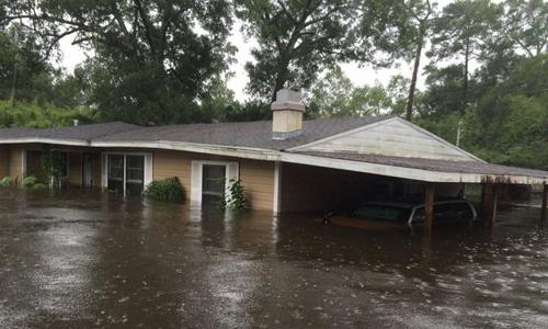 Ngôi nhà của Parry ngập trong nước lụt. Ảnh: Kyle Parry.