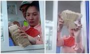 Nhân viên trạm Cai Lậy ấn còi báo động vì cục tiền lẻ gần một kg