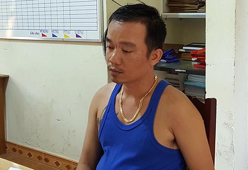 Nghi can bị bắt giữ. Ảnh: Khánh Hương