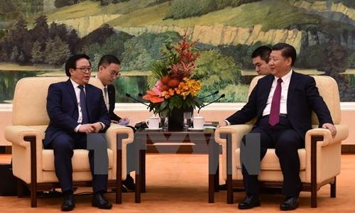 Tổng Bí thư Đảng Cộng sản Trung Quốc Tập Cận Bình tiếp ông Hoàng Bình Quân, Trưởng ban Đối ngoại Trung ương, Đặc phái viên của Tổng Bí thư Nguyễn Phú Trọng. (Ảnh: Minh Châu/TTXVN)