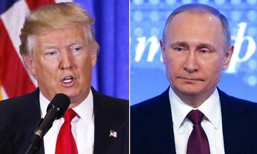 Tổng thống Mỹ Donald Trump (trái) và người đồng cấp Nga Vladimir Putin. Ảnh: Reuters.