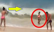 Người đẹp bikini bị sóng cuốn phăng khi đang tạo dáng