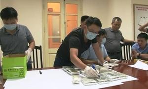 Đưa 16 bánh heroin, 50.000 viên ma túy về Hà Nội