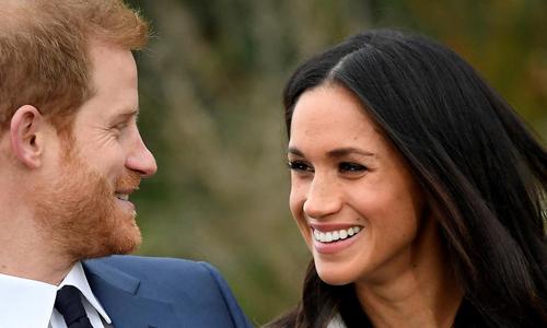 Hoàng tử Harry và hôn thê Meghan Markle. Ảnh: Reuters.