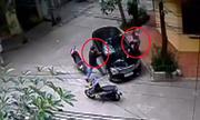 Đấm vỡ kính ôtô trộm túi xách trong 3 giây ở Hà Nội