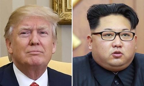 Tổng thống Mỹ Donald Trump (trái) và nhà lãnh đạo Triều Tiên Kim Jong-un. Ảnh: Kyodo.