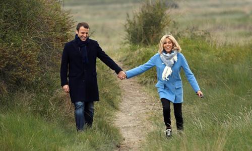 Tổng thống Pháp Emmanuel Macron và phu nhân Brigitte. Ảnh: AFP.