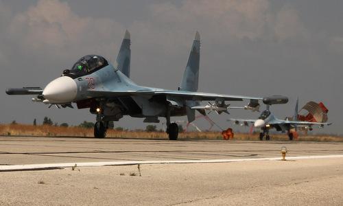 Tiêm kích Su-30SM Nga hạ cánh tại căn cứ Hmeymim. Ảnh: Sputnik.