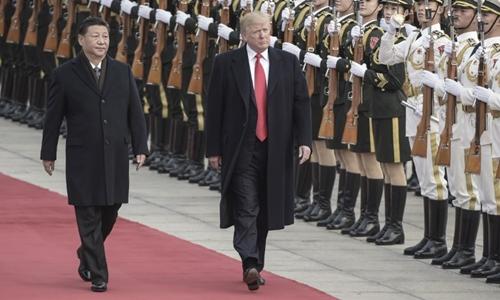 Chủ tịch Trung Quốc Tập Cận Bình và Tổng thống Mỹ Donald Trump trong lễ đón chính thức tại Bắc Kinh ngày 9/11. Ảnh: AFP.