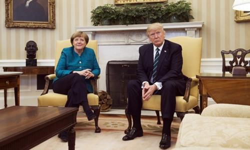 Trump tiếp Merkel tại Nhà Trắng hồi tháng 5. Ảnh: AFP.