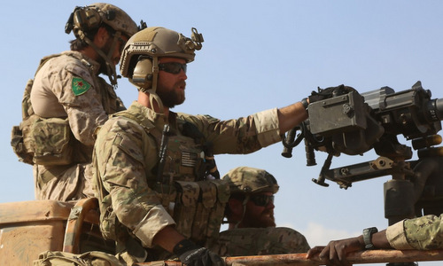 Lính đặc nhiệm Mỹ tham chiến cùng lực lượng người Kurd tại Syria. Ảnh: AFP.