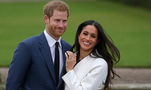 Hoàng tử Harry và hôn thê Meghan Markle. Ảnh: AFP.