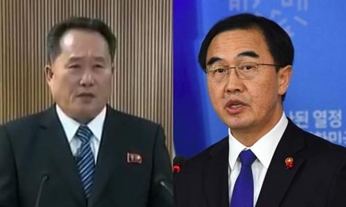 Ông Ri Son-gwon, chủ tịch Ủy ban Tái thống nhất Hòa bình Triều Tiên (trái), và V