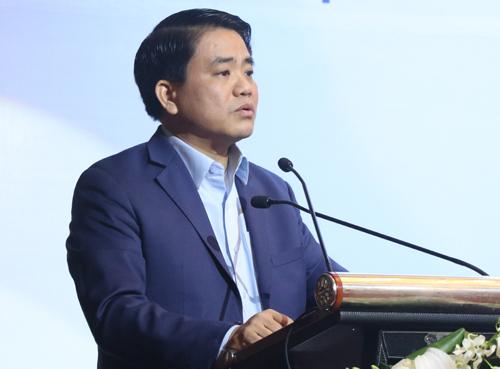 Chủ tịch UBND TP Hà Nội Nguyễn Đức Chung phát biểu tại hội thảo về cây xanh, hồ nước sáng 13/1. Ảnh: Võ Hải.