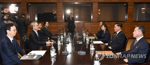 This photo, provided by Seouls unification ministry on Jan. 15, 2018, shows South and North Koreas holding of working-level talks on the Norths plan to send an art troupe to the South during next months PyeongChang Winter Olympics. (Yonhap) This photo, provided by Seouls unification ministry on Jan. 15, 2018, shows South and North Koreas holding of working-level talks on the Norths plan to send an art troupe to the South during next months PyeongChang Winter Olympics. (Yonhap)