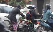 Người phụ nữ đi móc túi trên phố Hà Nội