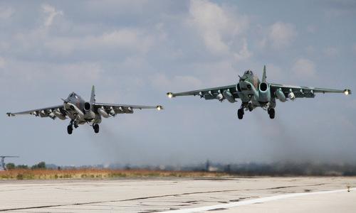 Biên đội Su-25 Nga xuất phát từ căn cứ Hmeymim tại Syria. Ảnh: Sputnik.