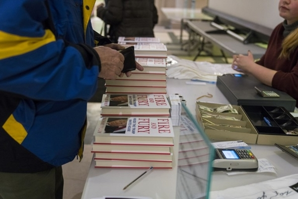 PHILADELPHIA, PA - JANUARY 16: People purchase author Michael Wolff's controversial book on the Trump administration titled