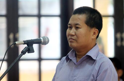 Bị cáo Lê Xuân Chính phủ nhận những lời khai của Quang. Ảnh: Đắc Thành.