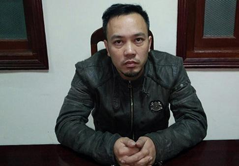 Nghi phạm Nguyễn Đức Minh tại cơ quan công an. Ảnh Công an nhân dân.