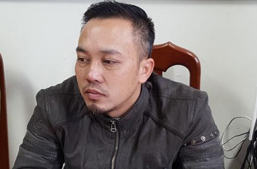 Nguyễn Đức Minh tại trụ sở công an.